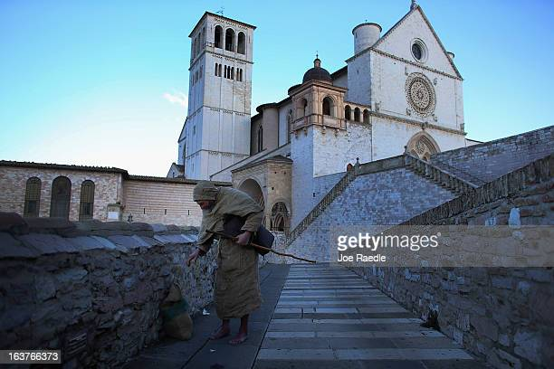 Franciscan friar Massimo Coppo walks near the Basilica of St Francis of Assisi which sits above the tomb of Saint Assisi on March 15 2013 in Assisi...