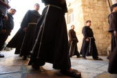 Franciscan monks walk into the Church of the Holy Sepulcher during Palm Sunday vigil on March 15 2008 in Jerusalems Old City where according to...