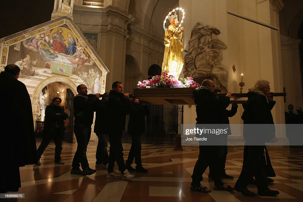 Franciscans carry a statue of the Virgin Mary as they walk in a procession during Mass at the Basilica of Santa Maria degli Angeli in Porziuncola to ask the Holy Spirit to assist Pope Francis in his new role on March 14, 2013 in Assisi, Italy. Cardinal Jorge Mario Begoglio took the name Francis after St. Francis of Assisi who had renounced a life of privilege, gave away all his possessions, wore a coarse woolen tunic and lived in a hut after taking a vow of poverty. The Basilica of Santa Maria degli Angeli is much venerated as the place of St. Francis' death.