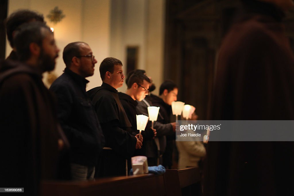Franciscans hold candles and pray during Mass at the Basilica of Santa Maria degli Angeli in Porziuncola to ask the Holy Spirit to assist Pope Francis in his new role on March 14, 2013 in Assisi, Italy. Cardinal Jorge Mario Begoglio took the name Francis after St. Francis of Assisi who had renounced a life of privilege, gave away all his possessions, wore a coarse woolen tunic and lived in a hut after taking a vow of poverty. The Basilica of Santa Maria degli Angeli is much venerated as the place of St. Francis' death.