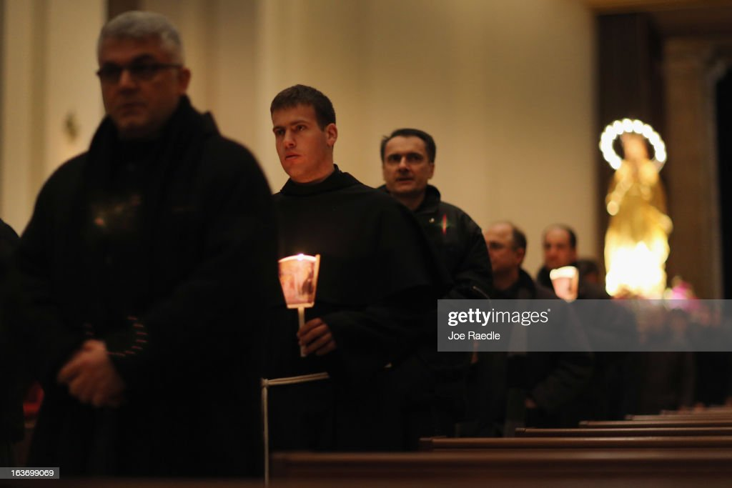 Franciscans hold candles as they walk in a procession during Mass at the Basilica of Santa Maria degli Angeli in Porziuncola to ask the Holy Spirit to assist Pope Francis in his new role on March 14, 2013 in Assisi, Italy. Cardinal Jorge Mario Begoglio took the name Francis after St. Francis of Assisi who had renounced a life of privilege, gave away all his possessions, wore a coarse woolen tunic and lived in a hut after taking a vow of poverty. The Basilica of Santa Maria degli Angeli is much venerated as the place of St. Francis' death.