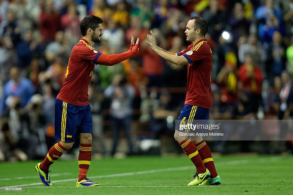 Francisco Alarcon alias <a gi-track='captionPersonalityLinkClicked' href=/galleries/search?phrase=Isco&family=editorial&specificpeople=5848609 ng-click='$event.stopPropagation()'>Isco</a> (L) closes his eyes as he celebrates with his teammate <a gi-track='captionPersonalityLinkClicked' href=/galleries/search?phrase=Andres+Iniesta&family=editorial&specificpeople=465707 ng-click='$event.stopPropagation()'>Andres Iniesta</a> (R) during the FIFA 2014 World Cup Qualifier match between Spain and Georgia at Carlos Belmonte stadium on October 15, 2013 in Albacete, Spain.
