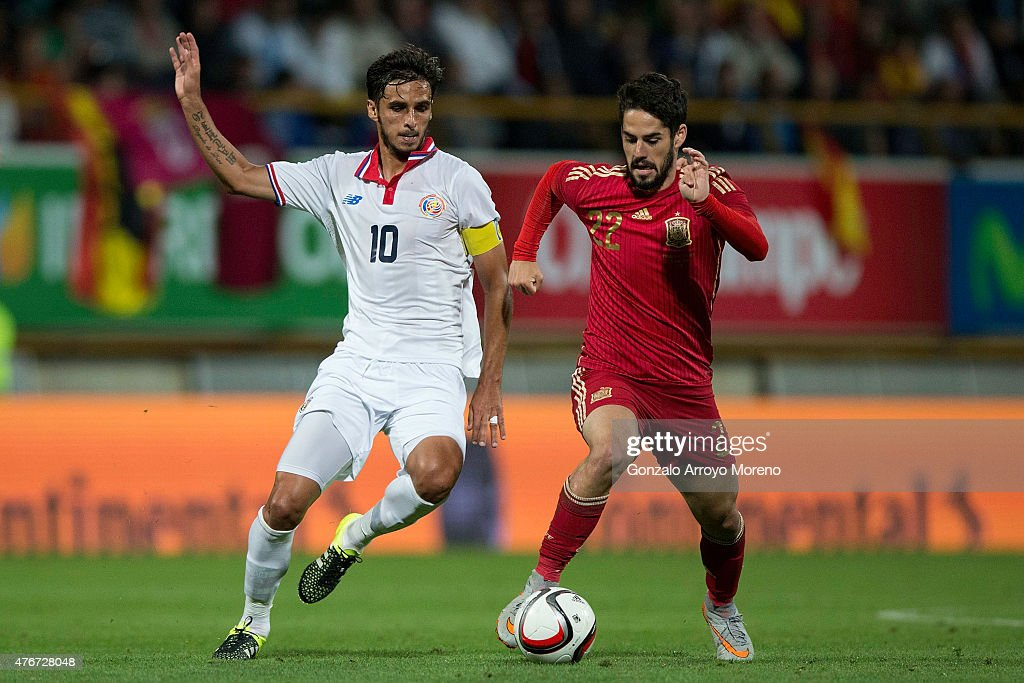 Francisco Alarcon alias Isco of Spain competes for the ball with Bryan Ruiz of Costa Rica during the international friendly match between Spain and...