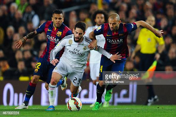 Francisco Alarcon Isco of Real Madrid CF competes for the ball with Dani Alves and Javier Mascherano of FC Barcelona during the La Liga match Between...