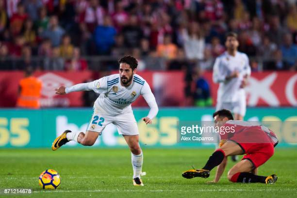 Francisco Alarcon 'Isco' of Real Madrid CF conducts the ball past Alex Granell of Girona FC during the La Liga match between Girona and Real Madrid...