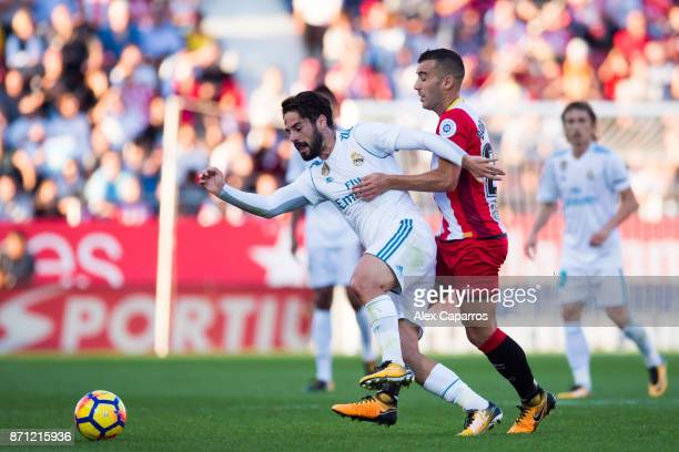 Francisco Alarcon 'Isco' of Real Madrid CF fights for the ball with Borja Garcia of Girona FC during the La Liga match between Girona and Real Madrid...