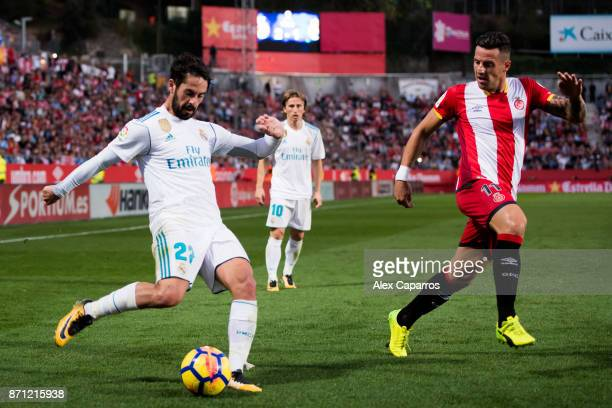 Francisco Alarcon 'Isco' of Real Madrid CF plays the ball under pressure from Francisco Aday of Girona FC during the La Liga match between Girona and...