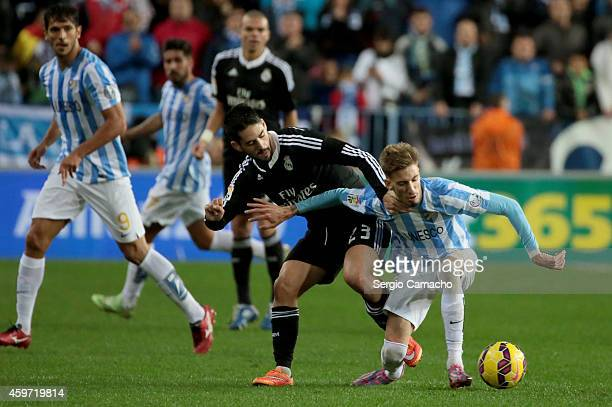 Francisco Alarcon Isco of Real Madrid duels for the ball with Samuel Castillejo of Malaga CF during the La Liga match between Malaga CF and Real...