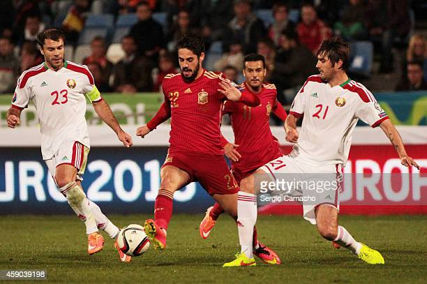 Francisco Alarcon of Spain controls the ball against Timofei Kalachev and Alexei Yanushkevich of Belarus during the UEFA EURO 2016 Group C Qualifier...