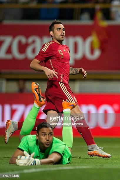 Francisco Alcacer of Spain runs behind goalkeeper Keylor Navas after scoring their opening goal during the international friendly match between Spain...