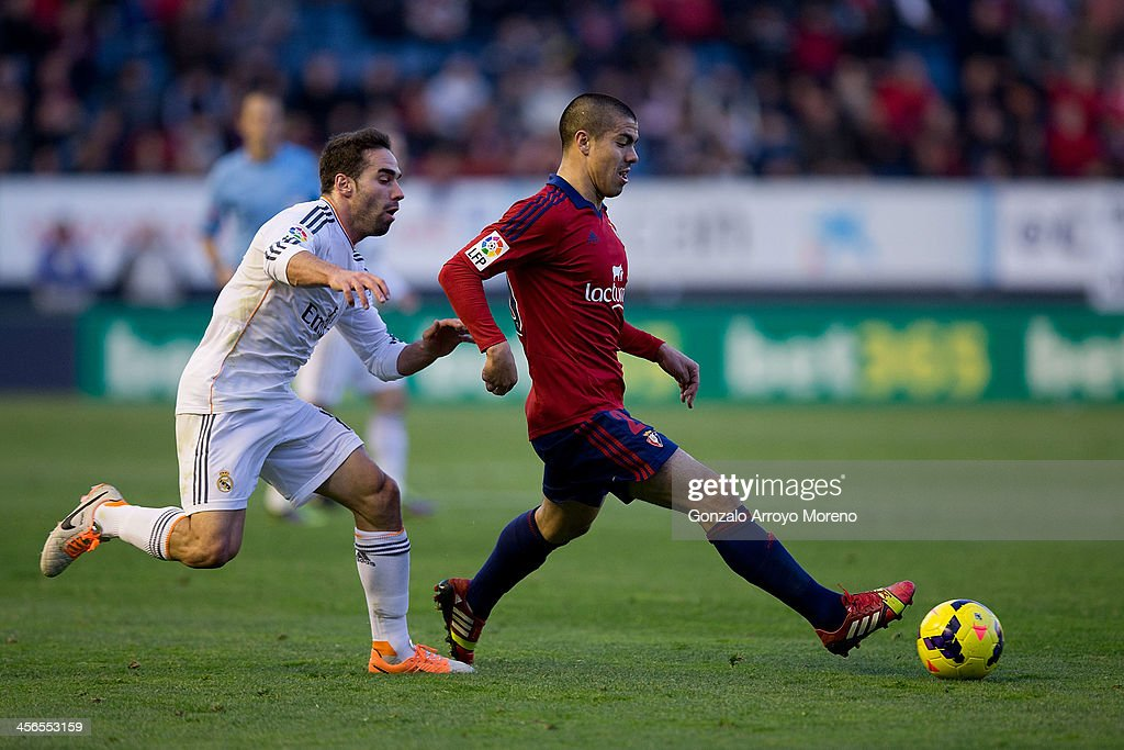 Francisco Andres Silva (R) of CA Osasuna competes for the ball with Daniel Carvajal (L) of Real Madrid CF during the La Liga match between CA Osasuna and Real Madrid CF at Estadio El Sadar de Navarra on December 14, 2013 in Pamplona, Spain.