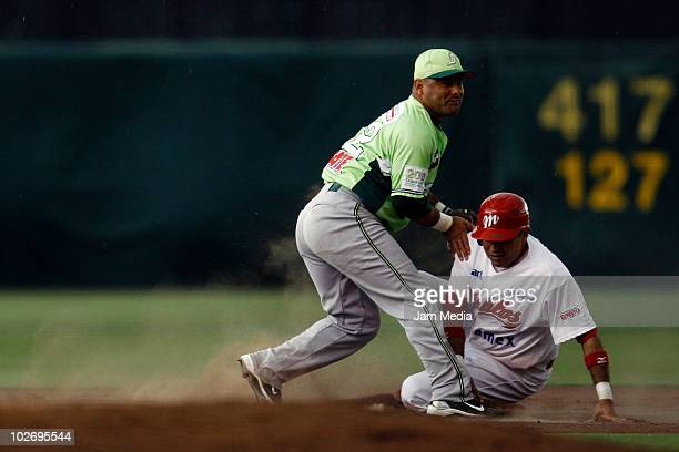 Francisco Arias of Broncos Reynosa and Oscar Robles of Diablos Rojos in action during a match as part of Mexican baseball league at the Foro Sol...