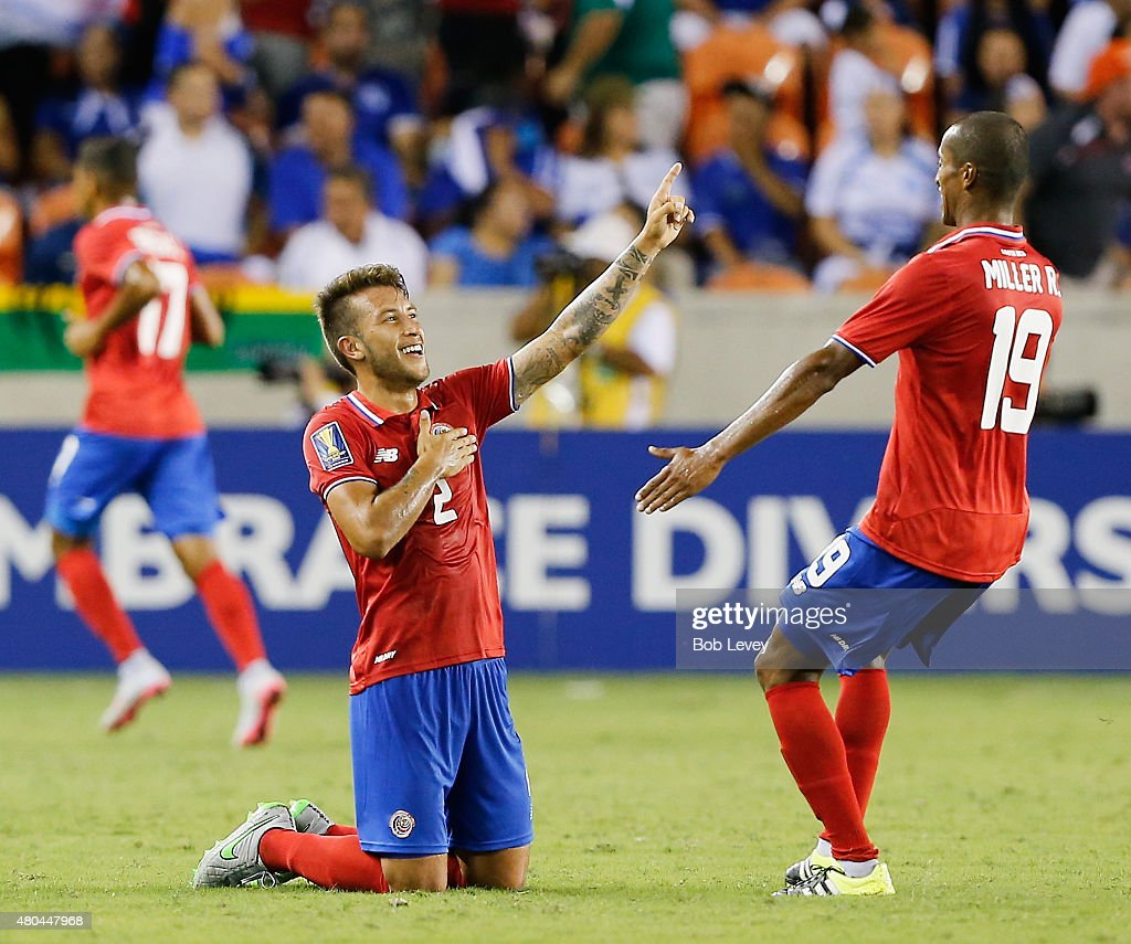 Francisco Calvo #2 of Costa Rica celebrates with Roy Miller #19 after a goal by teammate Bryan Ruiz in the second half at BBVA Compass Stadium on July 11, 2015 in Houston, Texas.