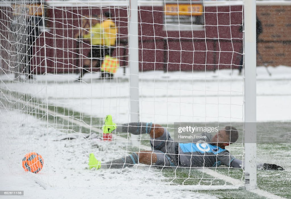 Francisco Calvo #5 of Minnesota United FC slides into the net after a goal scored by Josef Martinez #7 of Atlanta United FC during the second half of the match on March 12, 2017 at TCF Bank Stadium in Minneapolis, Minnesota. Atlanta defeated Minnesota 6-1.