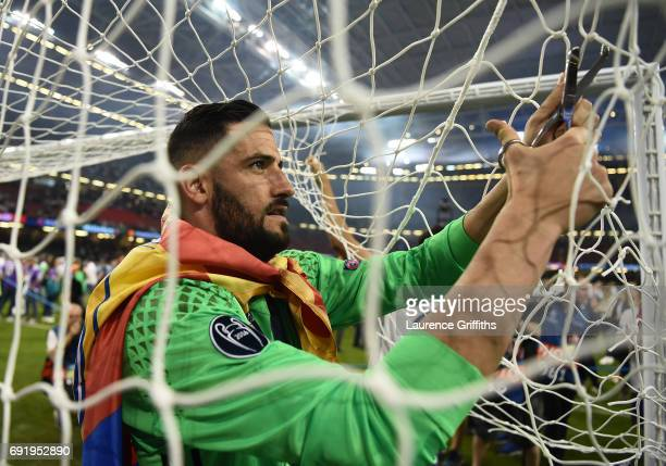 Francisco Casilla of Real Madrid cuts the goal net after the UEFA Champions League Final between Juventus and Real Madrid at National Stadium of...