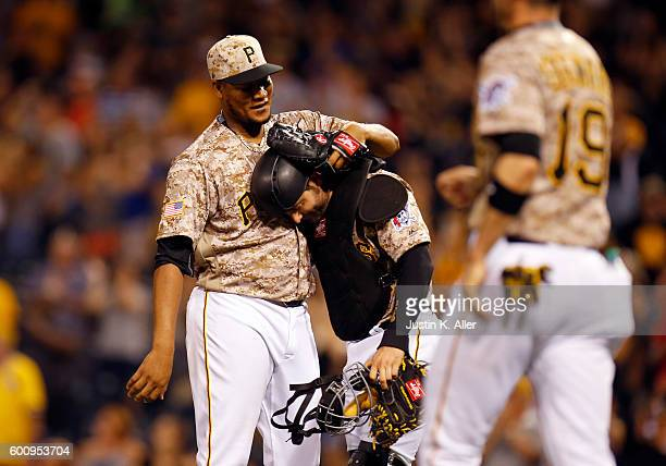 Francisco Cervelli celebrates with Ivan Nova of the Pittsburgh Pirates after a complete game win over the Cincinnati Reds 41 at PNC Park on September...