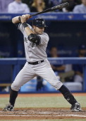 Francisco Cervelli of the New York Yankees bats during MLB game action against the Toronto Blue Jays on April 19 2013 at Rogers Centre in Toronto...