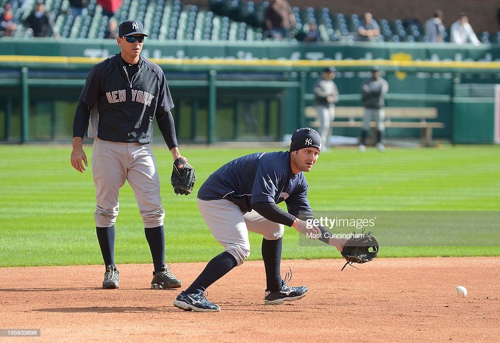 Francisco Cervelli #40 of the New York Yankees fields a grounder while Alex Rodriguez #13 looks on during warm ups prior to Game Four of the American League Championship Series against the Detroit Tigers at Comerica Park on October 18, 2012 in Detroit, Michigan. The Tigers defeated the Yankees 8-1 and now advance to the World Series.