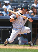 Francisco Cervelli of the New York Yankees is knocked down trying to bunt against the Cleveland Indians on May 31 2010 at Yankee Stadium in the Bronx...