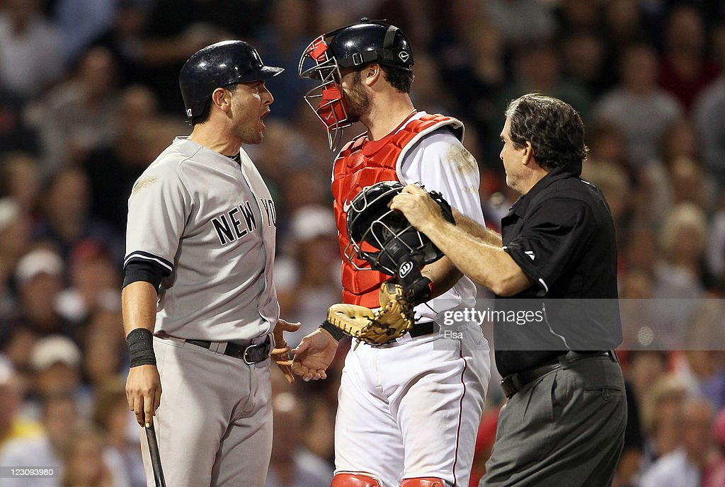 <a gi-track='captionPersonalityLinkClicked' href=/galleries/search?phrase=Francisco+Cervelli&family=editorial&specificpeople=4172506 ng-click='$event.stopPropagation()'>Francisco Cervelli</a> #17 of the New York Yankees reacts after he is hit by a pitch as catcher <a gi-track='captionPersonalityLinkClicked' href=/galleries/search?phrase=Jarrod+Saltalamacchia&family=editorial&specificpeople=836404 ng-click='$event.stopPropagation()'>Jarrod Saltalamacchia</a> #39 of the Boston Red Sox and home plate umpire <a gi-track='captionPersonalityLinkClicked' href=/galleries/search?phrase=Ed+Rapuano&family=editorial&specificpeople=234703 ng-click='$event.stopPropagation()'>Ed Rapuano</a> try to calm Cervelli down on August 30, 2011 at Fenway Park in Boston, Massachusetts.