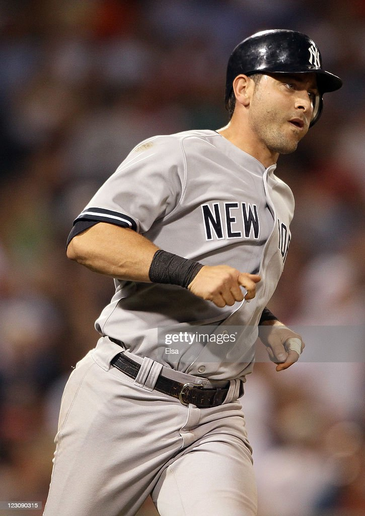 Francisco Cervelli #17 of the New York Yankees rounds the bases after he hit a solo home run in the fifth inning against the Boston Red Sox on August 30, 2011 at Fenway Park in Boston, Massachusetts.