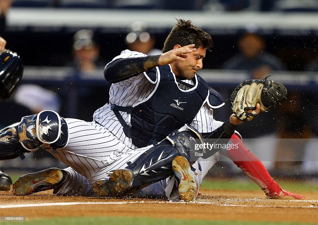 Francisco Cervelli #29 of the New York Yankees tags out Shane Victorino #18 of the Boston Red Sox in the first inning on April 4, 2013 at Yankee Stadium in the Bronx borough of New York City.