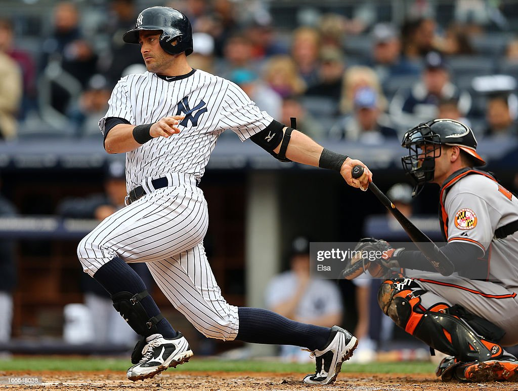 <a gi-track='captionPersonalityLinkClicked' href=/galleries/search?phrase=Francisco+Cervelli&family=editorial&specificpeople=4172506 ng-click='$event.stopPropagation()'>Francisco Cervelli</a> #29 of the New York Yankees watches his hit as <a gi-track='captionPersonalityLinkClicked' href=/galleries/search?phrase=Matt+Wieters&family=editorial&specificpeople=4498276 ng-click='$event.stopPropagation()'>Matt Wieters</a> #32 of the Baltimore Orioles catches on April 13, 2013 at Yankee Stadium in the Bronx borough of New York City.