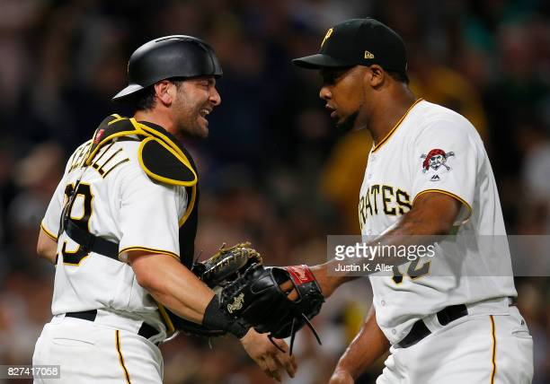 Francisco Cervelli of the Pittsburgh Pirates and Juan Nicasio of the Pittsburgh Pirates celebrate after defeating the Detroit Tigers 30 during...