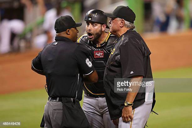 Francisco Cervelli of the Pittsburgh Pirates argues after being thrown out by umpire Alan Porter during the third inning of the game against the...