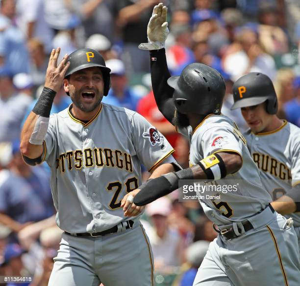 Francisco Cervelli of the Pittsburgh Pirates celebrates hitting a grand slam home run in the 1st inning against the Chicago Cubs with teammate Josh...