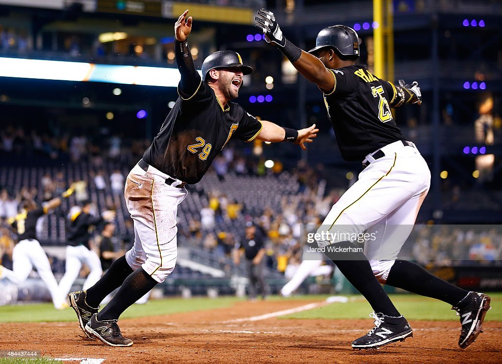 <a gi-track='captionPersonalityLinkClicked' href=/galleries/search?phrase=Francisco+Cervelli&family=editorial&specificpeople=4172506 ng-click='$event.stopPropagation()'>Francisco Cervelli</a> #29 of the Pittsburgh Pirates celebrates with teammate <a gi-track='captionPersonalityLinkClicked' href=/galleries/search?phrase=Gregory+Polanco&family=editorial&specificpeople=11178456 ng-click='$event.stopPropagation()'>Gregory Polanco</a> #25 after sliding safely into home plate to score the game winning run in the 15th inning against the Arizona Diamondbacks during the game at PNC Park on August 18, 2015 in Pittsburgh, Pennsylvania.