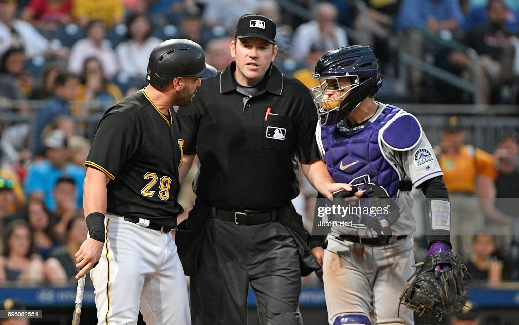 Francisco Cervelli #29 of the Pittsburgh Pirates has words with Tony Wolters #14 of the Colorado Rockies after being hit by a pitch in the fifth inning during the game at PNC Park on June 14, 2017 in Pittsburgh, Pennsylvania.