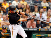 Francisco Cervelli of the Pittsburgh Pirates hits a grand slam in the fourth inning during game one of the doubleheader against the St Louis...