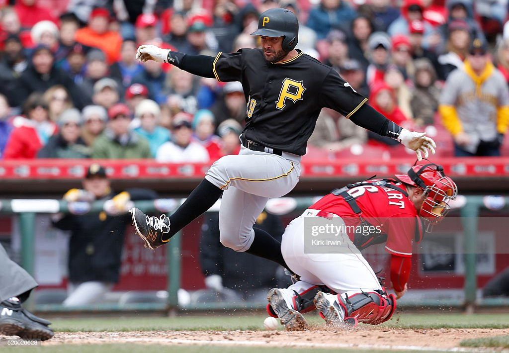 <a gi-track='captionPersonalityLinkClicked' href=/galleries/search?phrase=Francisco+Cervelli&family=editorial&specificpeople=4172506 ng-click='$event.stopPropagation()'>Francisco Cervelli</a> #29 of the Pittsburgh Pirates jumps past Tucker Barnhart #16 of the Cincinnati Reds to score during the sixth inning at Great American Ball Park on April 9, 2016 in Cincinnati, Ohio. Cincinnati defeated Pittsburgh 5-1.