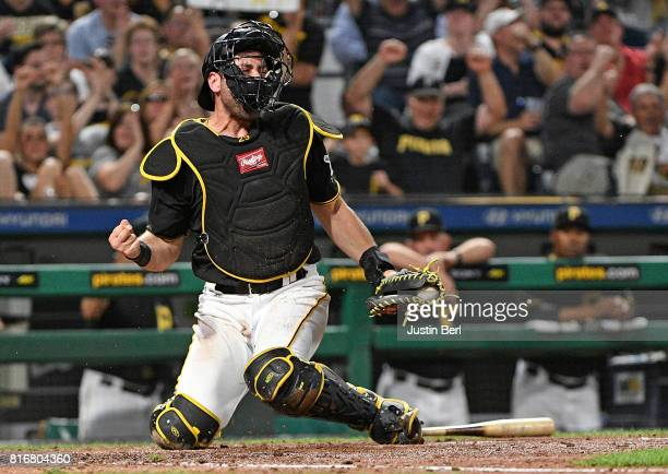 Francisco Cervelli of the Pittsburgh Pirates reacts after tagging out Manny Pina of the Milwaukee Brewers at home plate in the sixth inning during...