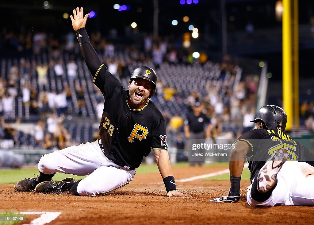 <a gi-track='captionPersonalityLinkClicked' href=/galleries/search?phrase=Francisco+Cervelli&family=editorial&specificpeople=4172506 ng-click='$event.stopPropagation()'>Francisco Cervelli</a> #29 of the Pittsburgh Pirates slides safely into home plate to score the game winning run in the 15th inning against the Arizona Diamondbacks during the game at PNC Park on August 18, 2015 in Pittsburgh, Pennsylvania.