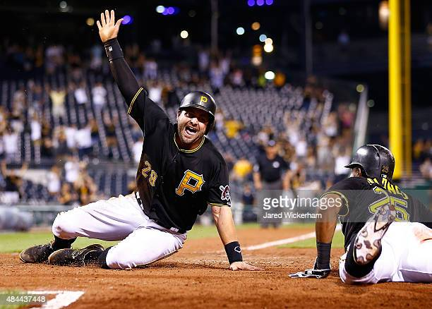 Francisco Cervelli of the Pittsburgh Pirates slides safely into home plate to score the game winning run in the 15th inning against the Arizona...