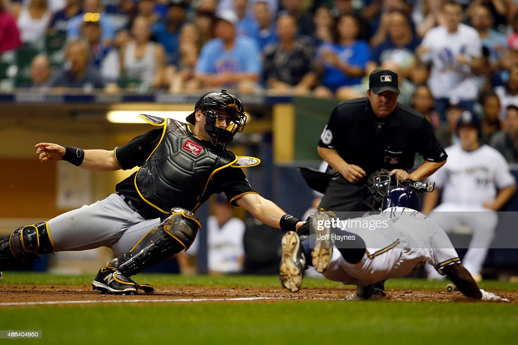 Francisco Cervelli of the Pittsburgh Pirates tags out Elian Herrera of the Milwaukee Brewers during the sixth inning at Miller Park on September 3...
