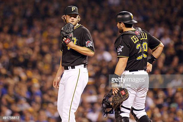 Francisco Cervelli of the Pittsburgh Pirates visits Gerrit Cole of the Pittsburgh Pirates on the pitcher's mound in the first inning during the...