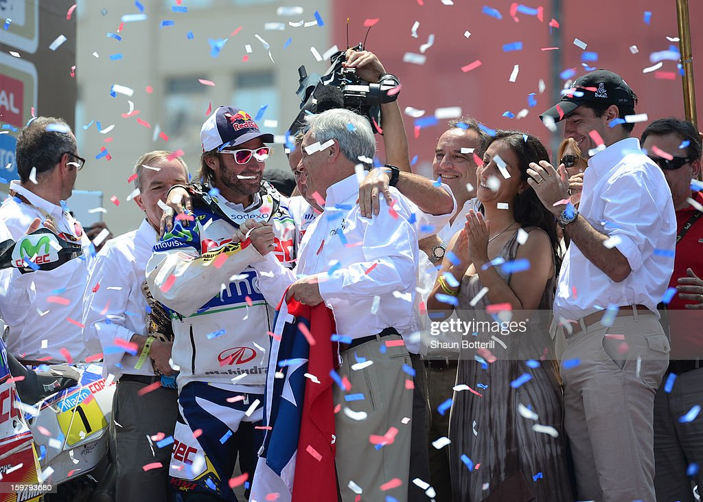 Francisco Chaleco Lopez Contardo of Chile, 3rd place in Motos, celebrates with President <a gi-track='captionPersonalityLinkClicked' href=/galleries/search?phrase=Sebastian+Pinera&family=editorial&specificpeople=768332 ng-click='$event.stopPropagation()'>Sebastian Pinera</a> during the podium presentations at the end of the 2013 Dakar Rally on January 20, 2013 in Santiago, Chile.
