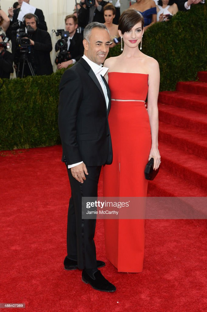 Francisco Costa and Anne Hathaway attend the 'Charles James: Beyond Fashion' Costume Institute Gala at the Metropolitan Museum of Art on May 5, 2014 in New York City.