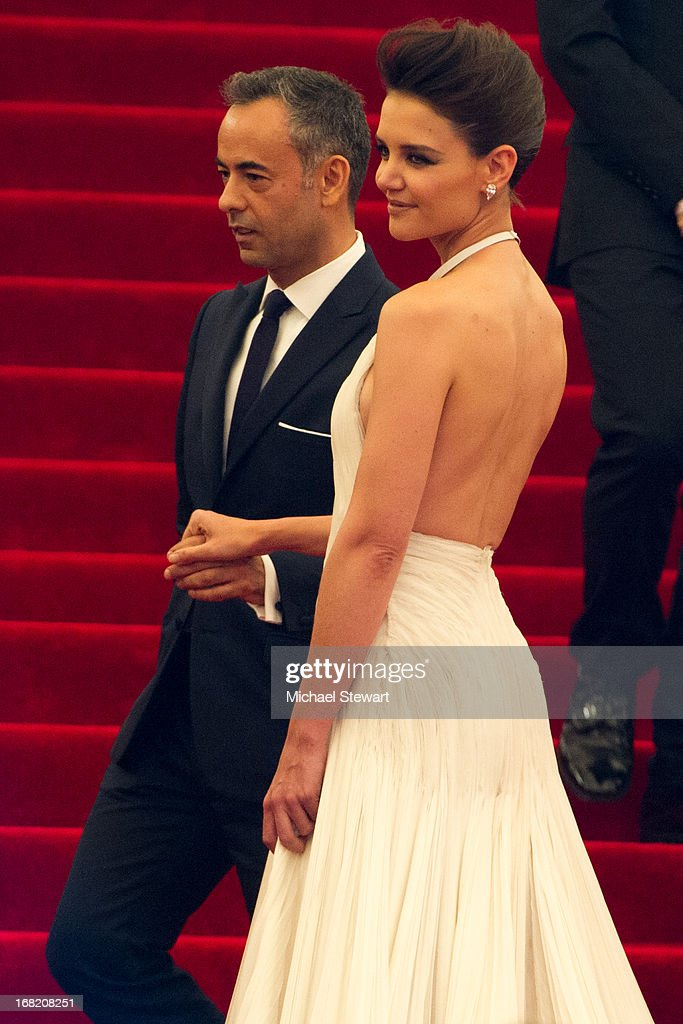 Francisco Costa (L) and <a gi-track='captionPersonalityLinkClicked' href=/galleries/search?phrase=Katie+Holmes&family=editorial&specificpeople=201598 ng-click='$event.stopPropagation()'>Katie Holmes</a> attend the Costume Institute Gala for the 'PUNK: Chaos to Couture' exhibition at the Metropolitan Museum of Art on May 6, 2013 in New York City.