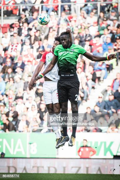 Francisco da Silva Caiuby of Augsburg and Salif Sane of Hannover 96 jump for a header during the Bundesliga match between FC Augsburg and Hannover 96...