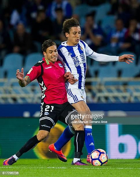 Francisco Femenia of Deportivo Alaves duels for the ball with Mikel Oyarzabal of Real Sociedad during the La Liga match between Real Sociedad de...