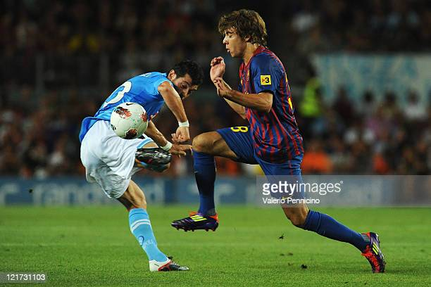 Francisco Femenia of FC Barcelona competes with Blerin Dzemaili of SSC Napoli during the Joan Gamper Trophy match between FC Barcelona and SSC Napoli...