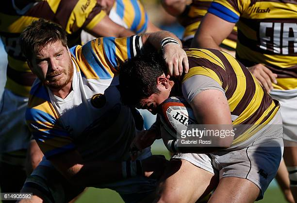 Francisco Ferronato of Belgrano Athletic is tackled by Agustin Schab of Hindu during a match between Belgrano Athletic and Hindu Club as part of the...