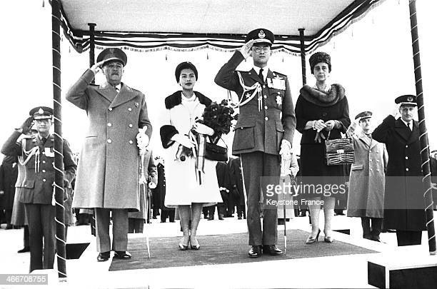 Francisco Franco and King Bhumibol Adulyadej of Thailand aka Rama IX during the national anthems at the airport of Madrid Barajas Behind them their...