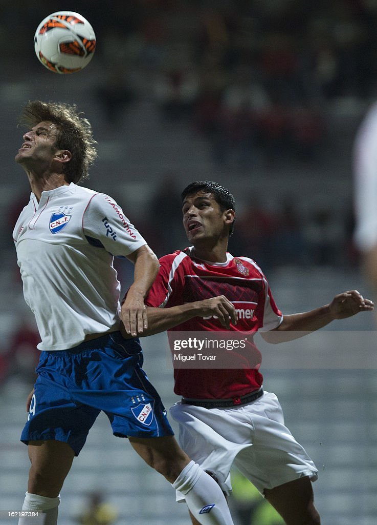 Francisco Gamboa of Toluca (R) fights for the ball with <a gi-track='captionPersonalityLinkClicked' href=/galleries/search?phrase=Ivan+Alonso&family=editorial&specificpeople=2474444 ng-click='$event.stopPropagation()'>Ivan Alonso</a> of Nacional de Uruguay (L) during a match for the Bridgestone Libertadores Cup at Nemesio Diez on February 19, 2013 in Toluca, Mexico.
