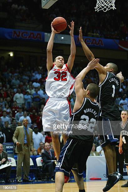 Francisco Garcia of Louisville takes a shot over Mike Monserez of Butler during the NCAA Tournament on March 23 2003 at the Birmingham Civic Center...