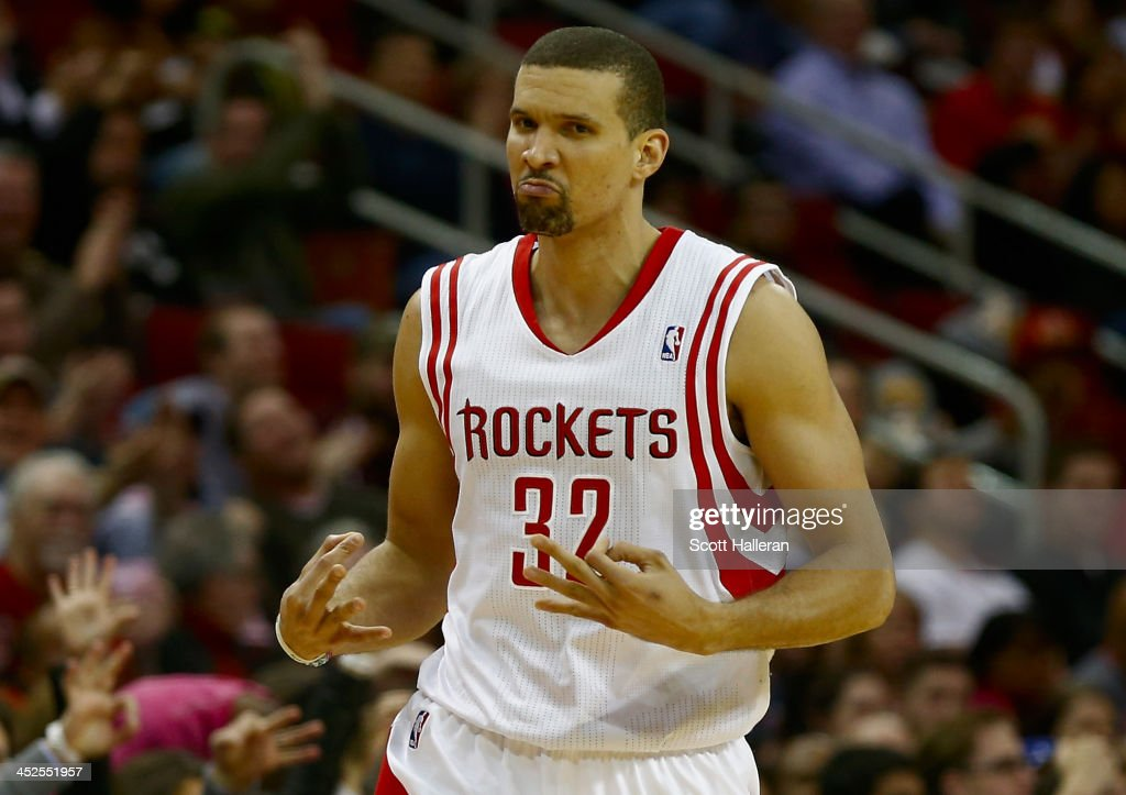 Francisco Garcia #32 of the Houston Rockets celebrates a three-point shot during the game against the Brooklyn Nets at Toyota Center on November 29, 2013 in Houston, Texas.
